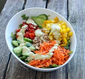 fresh salad with tahini avocado dressing